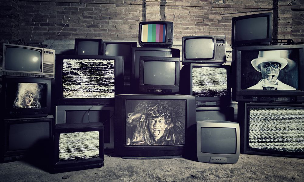 stacked televisions