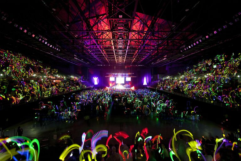 You don't have to throw a rave to host an epic glow party. Start with glow sticks and a black light and get the party started!