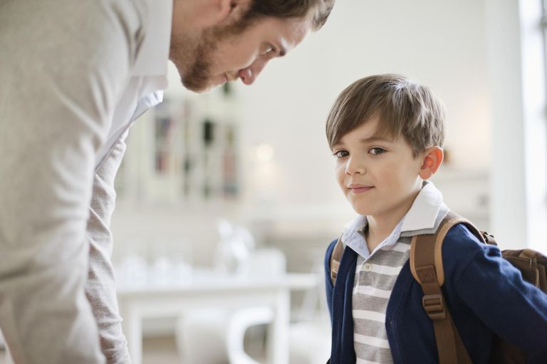 Man and his son with schoolbag