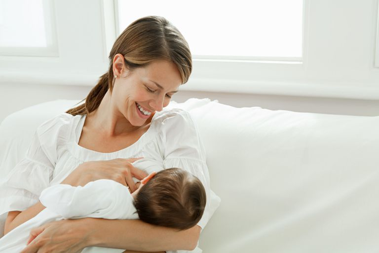 Mother breastfeeding child