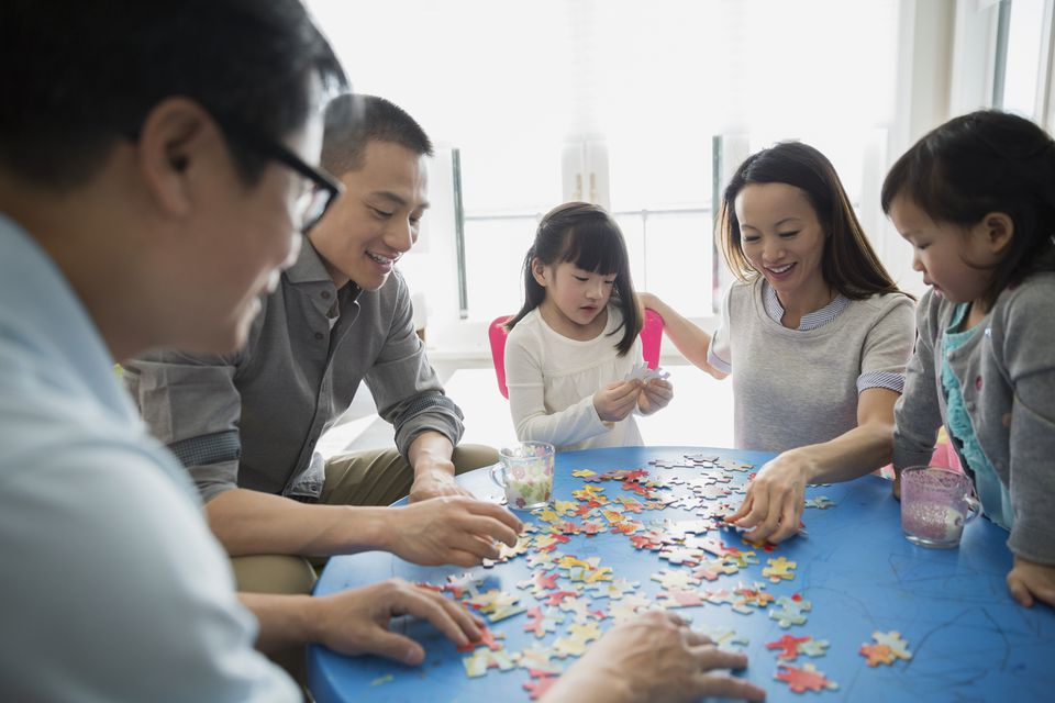 Family working on jigsaw puzzle
