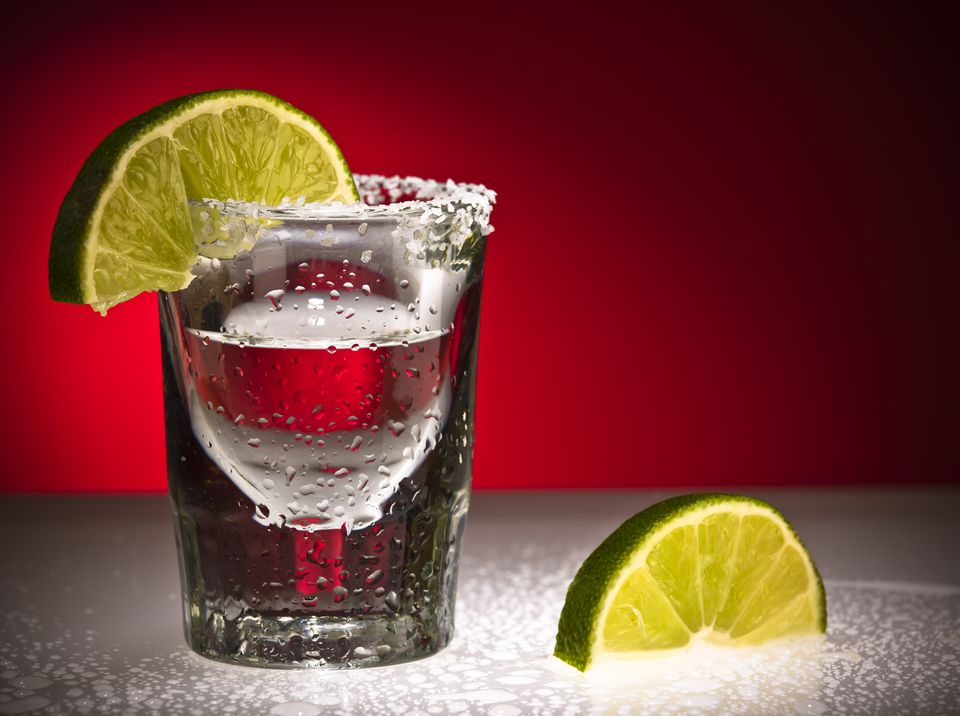 Close up Of Tequila Shot Glass and Limes