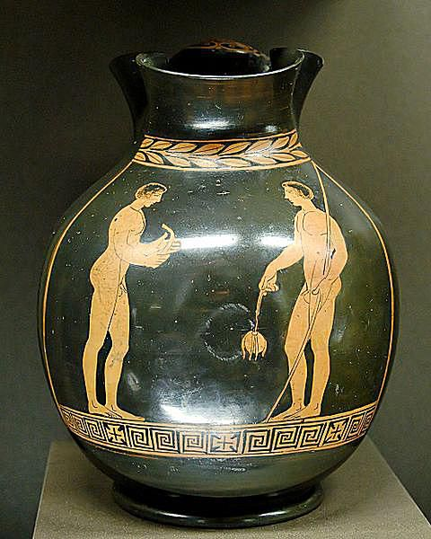 Two athletes: the one on the left holds a strigil; the one on the right an aryballos.