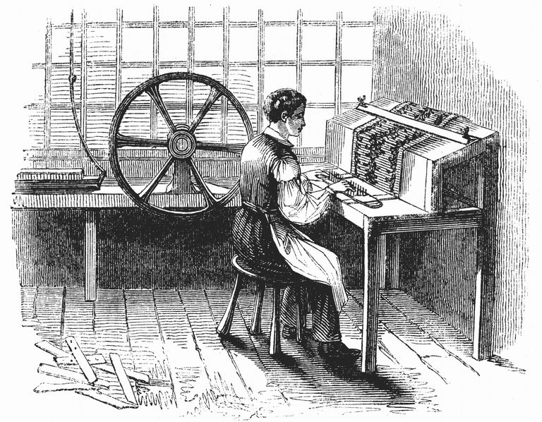 Man operating machine punching cards for Jacquard looms, 1844.