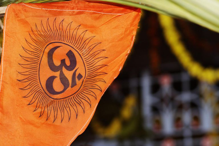 A saffron coloured cloth with a an Om symbol on it