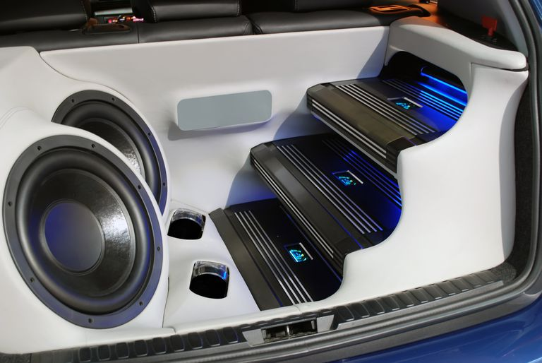 Car audio system, including speakers, subs, and amps in the back of a vehicle.