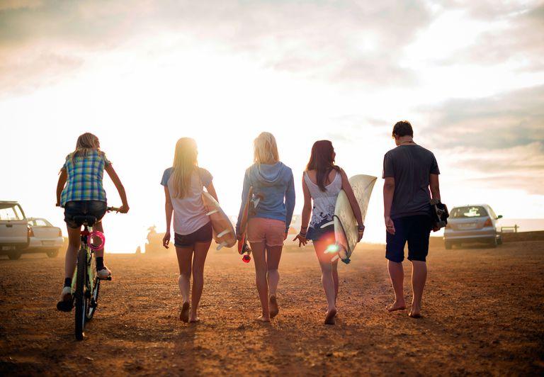 Five kids walking on beach