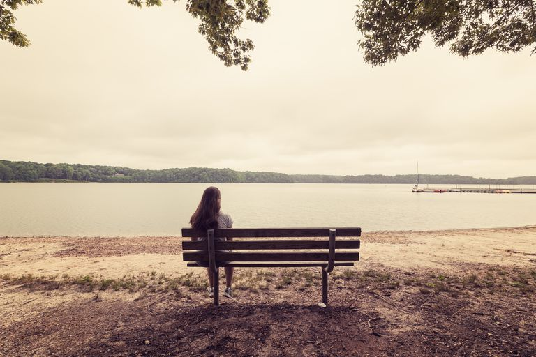 Girl Meditating on a Bench