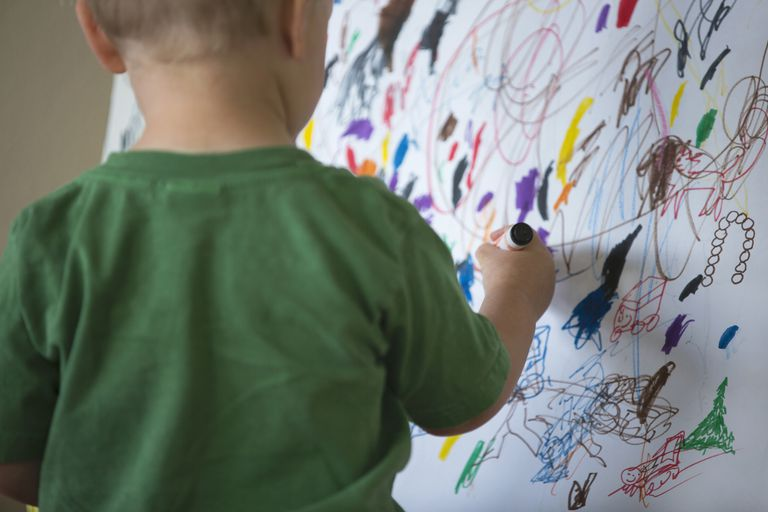 Toddler drawing on wall