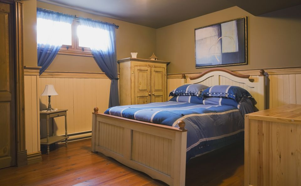 Basement bedroom inside a replica canadiana cottage style home