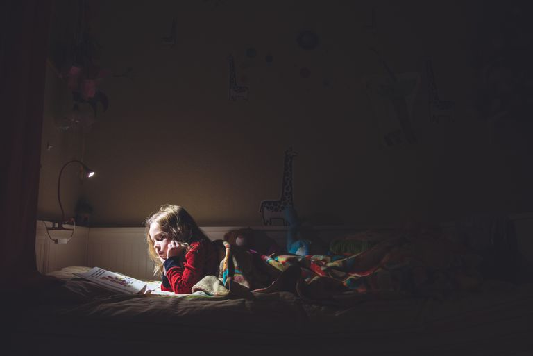 girl reading at night