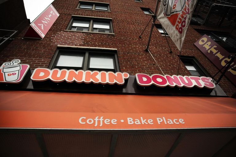 A Dunkin' Donuts cafe is viewed on July 25, 2013 in New York City. In a surprise to Wall Street, Dunkin' Donuts reported a same-store sales rise of 4 percent for the latest quarter. The coffee, donut and sandwich chain also announced its return to California with a deal for 45 new cafes in Southern California.