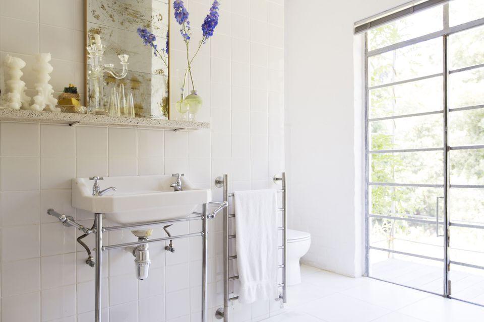 Sink and towel rack in rustic bathroom