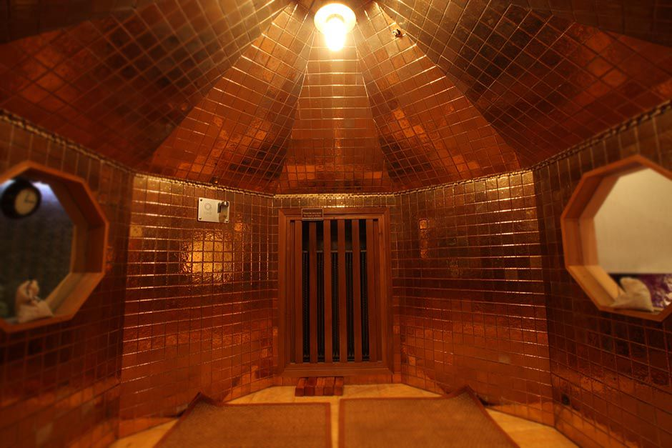 A gold-lined sauna at Spa Castle in Queens