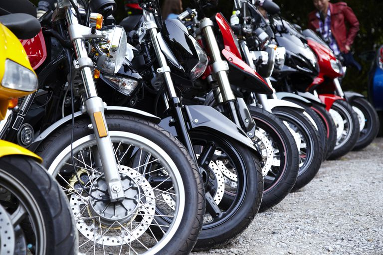 Motorcycles lined up while parked