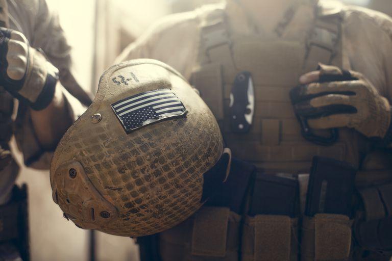 American flag on helmet of US Marine soldier.