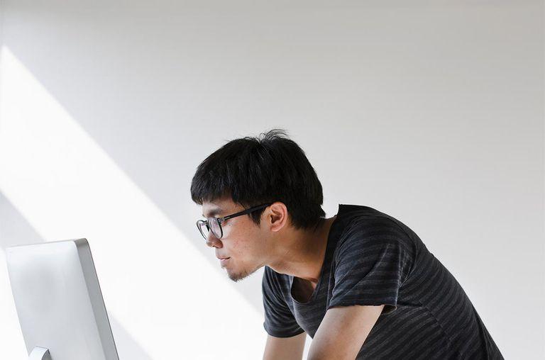 Young man looking at computer