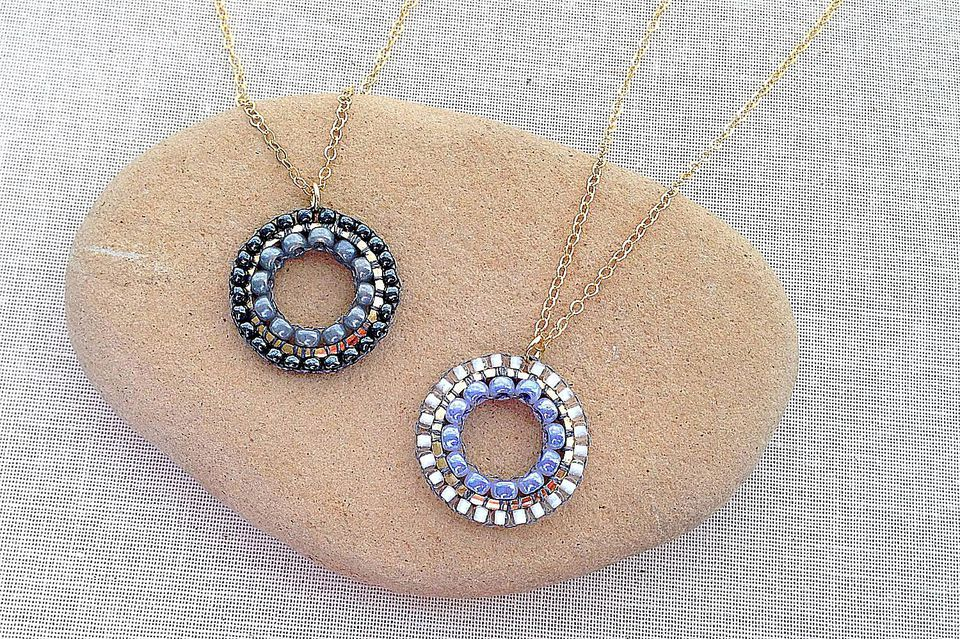 Pendants with brick stitch beadwork inside and outside a link connector