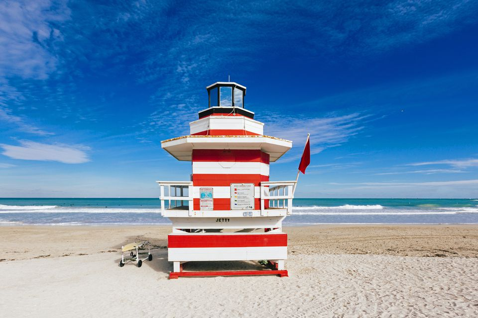 Red and white striped lifeguard hut stylized as lighthouse in South Beach, Miami, Florida, USA