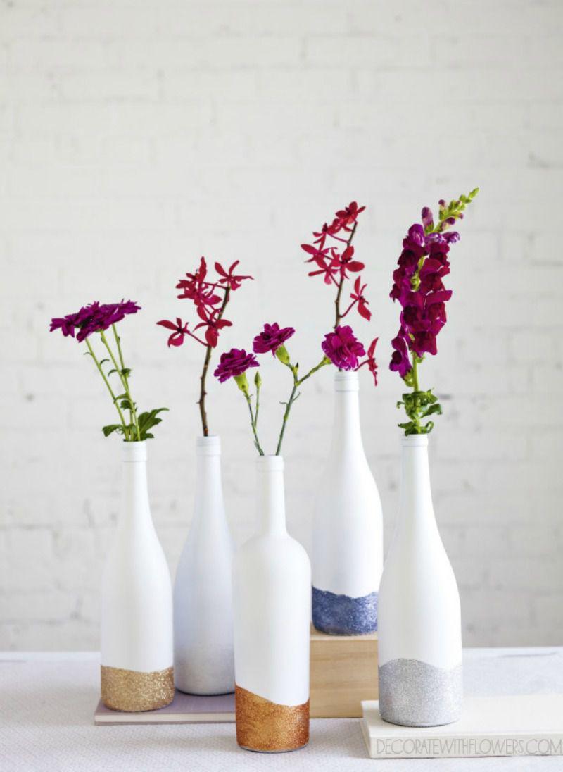 glitter dipped wine bottle vases