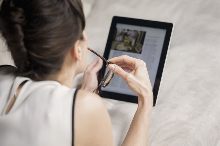 Woman Reading Tablet