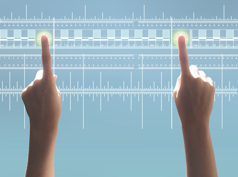 Hand touching two points on digital ruler