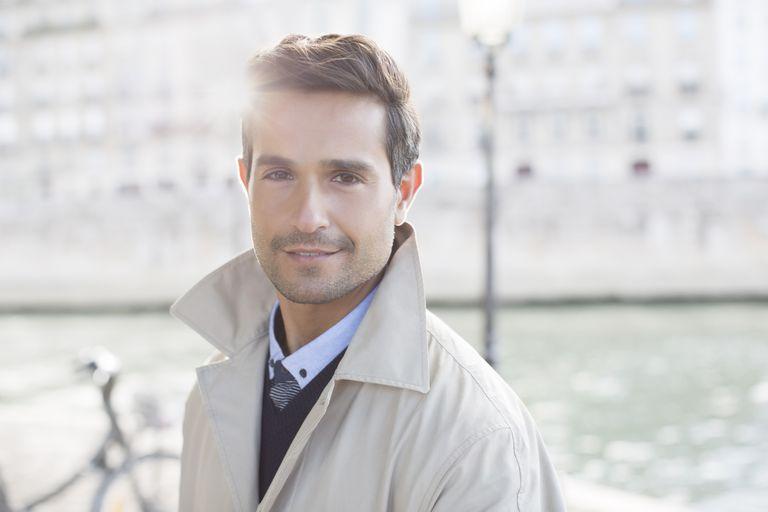 Businessman smiling along Seine River, Paris, France