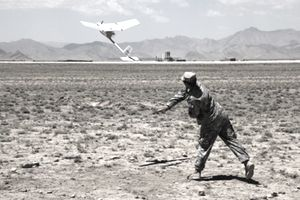 U.S. Army soldier launches an RQ-11 Raven unmanned aerial vehicle.