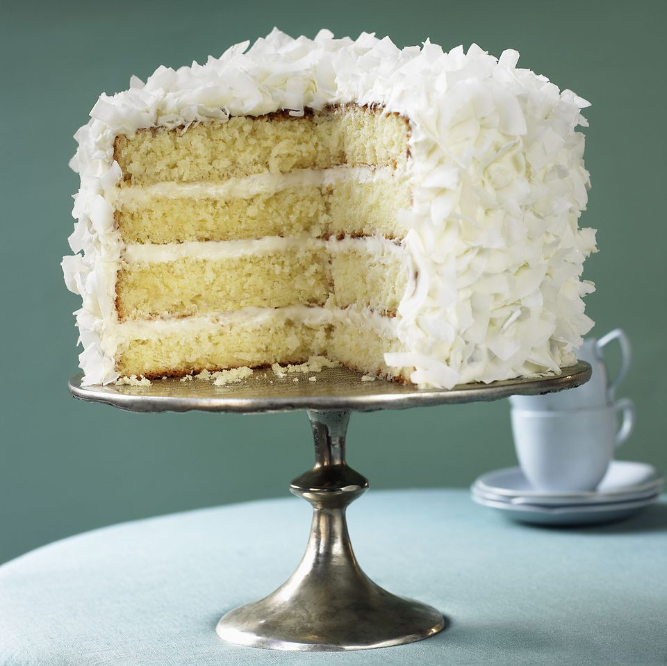 A coconut cake on a serving tray