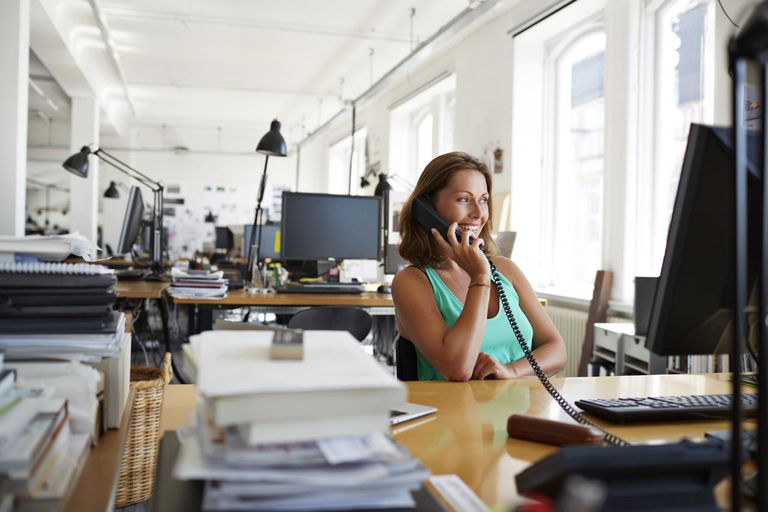 Businesswoman o the phone at design agency