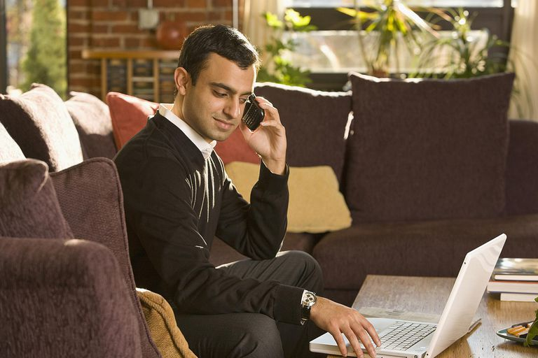Man on phone at home