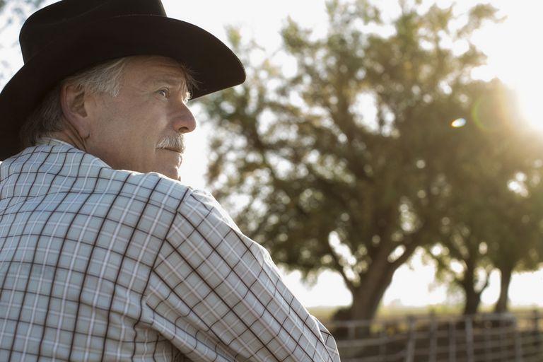 Caucasian rancher looking away