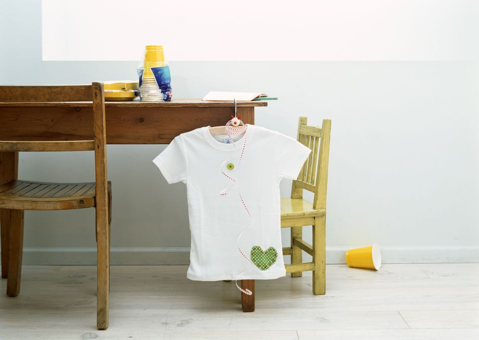 Appliqued t-shirt hanging on desk