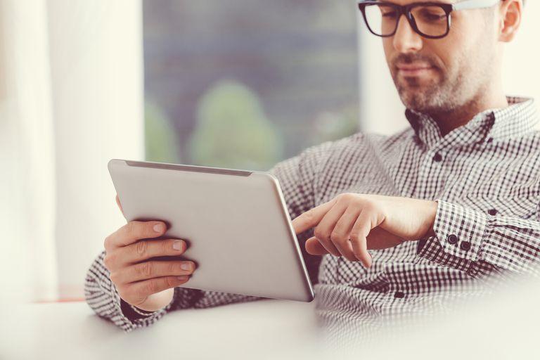 Handsome man using a digital tablet