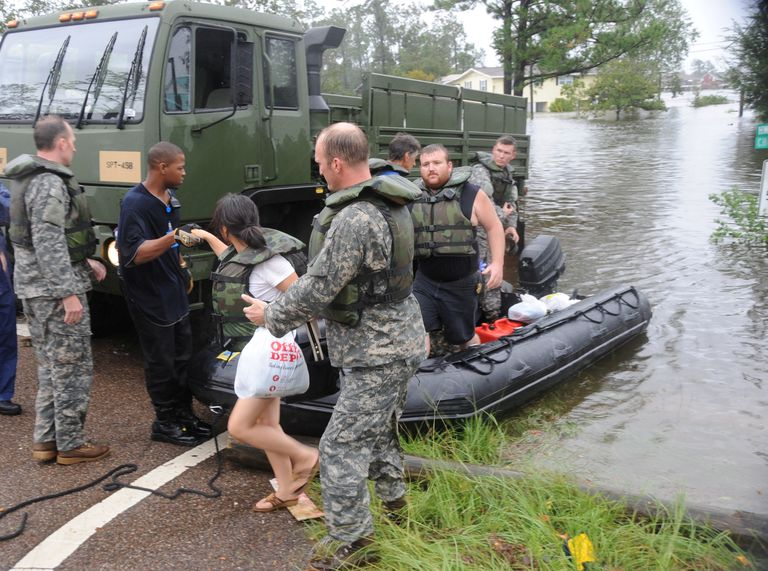 National Guard assisting woman