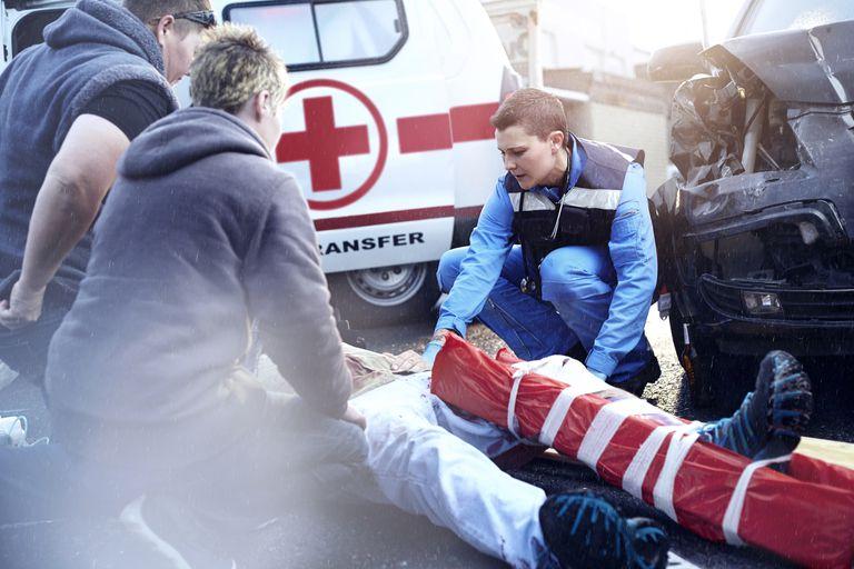 EMT transporting car accident victim