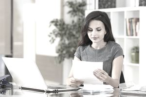 Businesswoman reading a letter at office