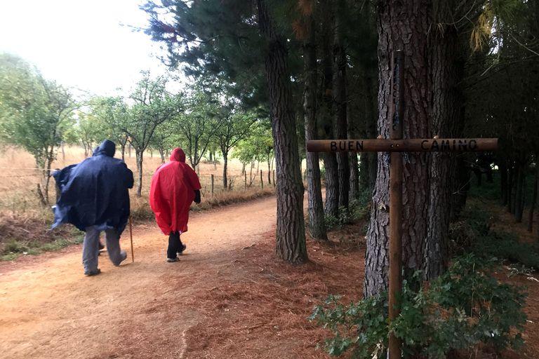 Peregrinos with Rain Ponchos Leave Portomarin