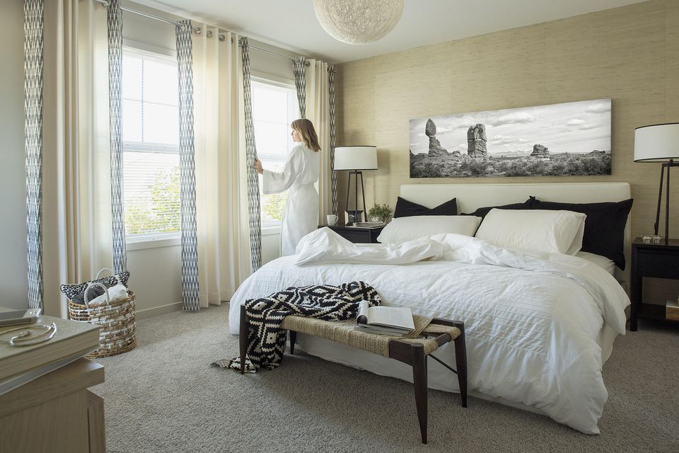 Gorgeous neutral and black master bedroom.