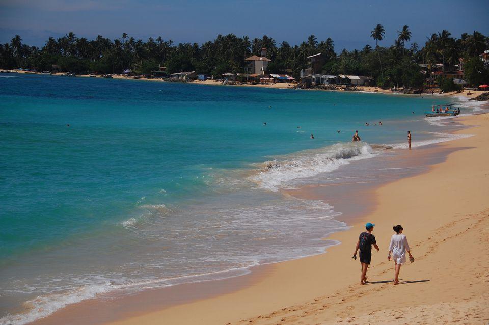 People walking on Unawatuna Beach in Sri Lanka
