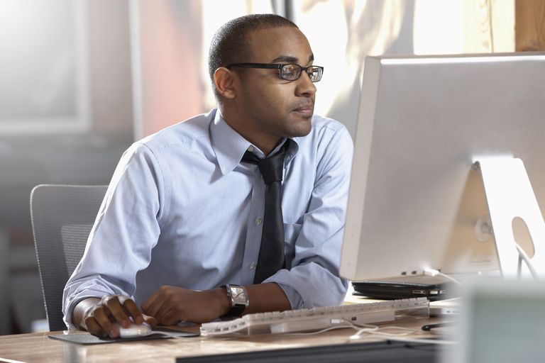 African American businessman working at desk