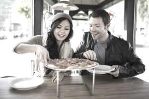 Young couple eating pizza.