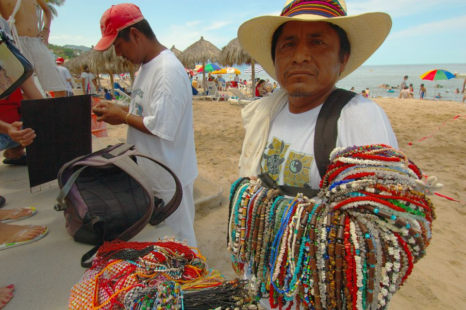 Beach vendor on Playa de los Muertos (Beach of the Dead) / Playa de la Sol (Beach of the Sun).