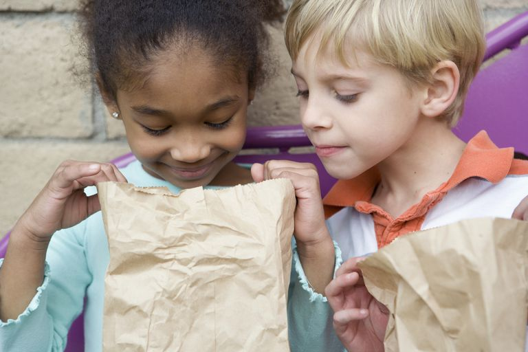 children looking in lunch bag