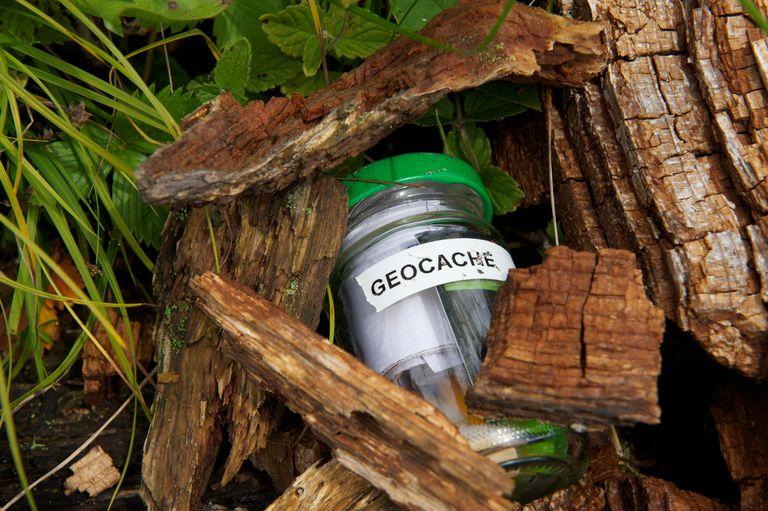 Geocache jar under some pieces of wood