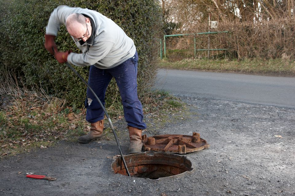 Man clearing the drains