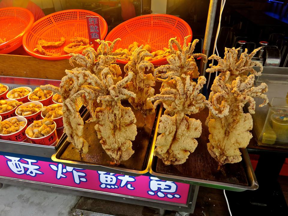 Deep Fried Calamari On Skewers On Market Stall