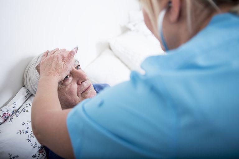 nurse checking for fever