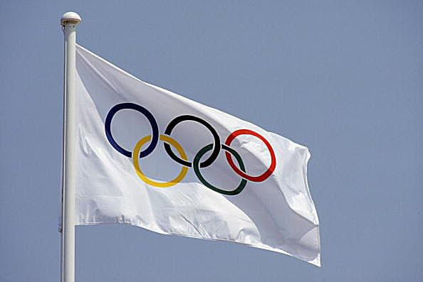 A picture of the Olympic flag.