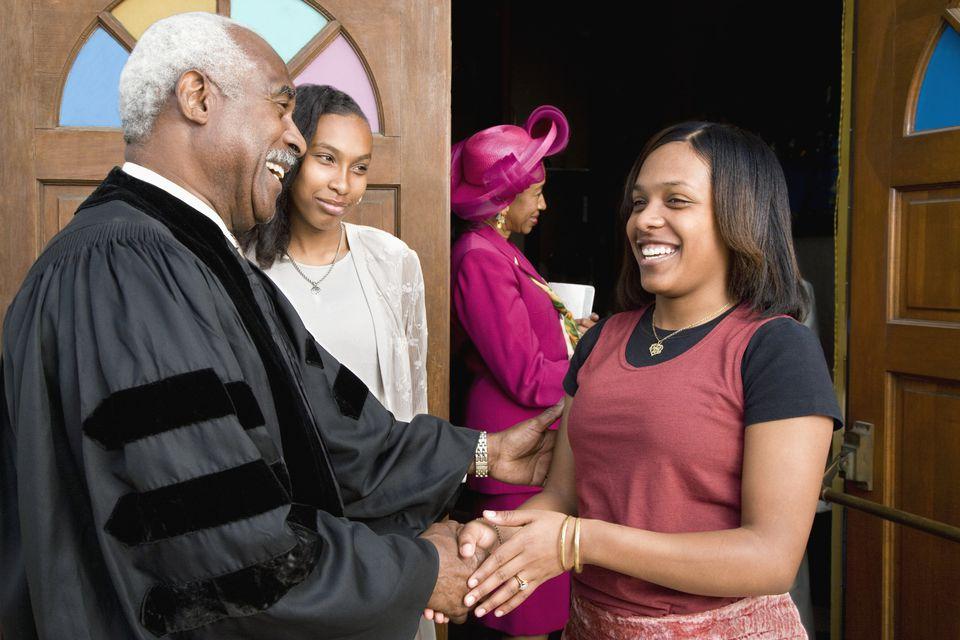 Pastor greeting church visitor